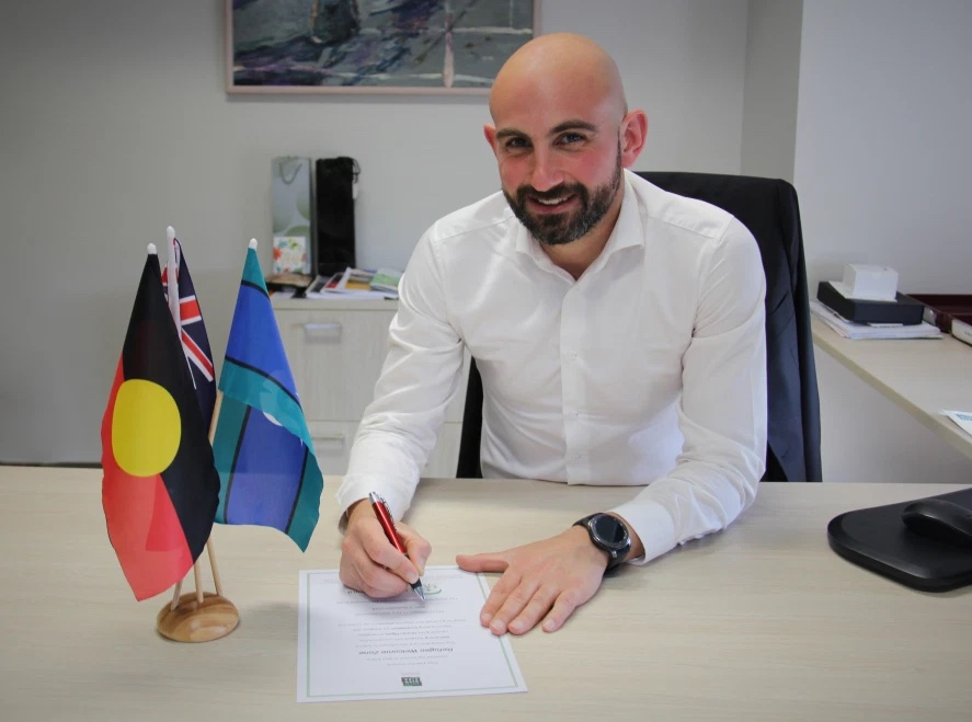 Glen Eira City Council  Mayor, Cr Tony Athanasopoulos, signs the Refugee Welcome Zone Declaration
